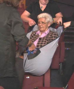 An incapacitated lady is safely moved from the auditorium